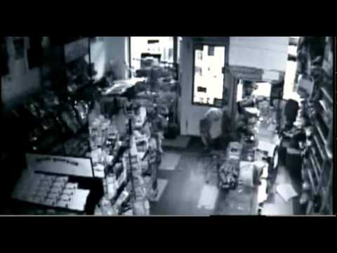 Surveillance Video: Stupid criminal falls from the Ceiling breaking into store…