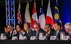 United States Trade Representative Michael Froman (C) is flanked by international counterparts during the closing press conference after an agreement was reachef by twelve Trans-Pacific Partnership (TPP) member countries, in Atlanta, Georgia, USA