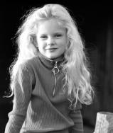Taylor Swift at age 5 in black and white.