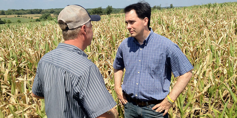 Governor Walker discusses the impact of the 2012 drought with a farmer. 07/20/12