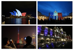 Left-Right from the top: The Sydney Opera House, The Brandenburg Gate in Berlin, Shanghai's Oriental Pearl Tower, and the Municipal Palace of Puebla, Mexico, on 14 November 2015.