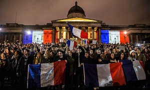 Hundreds of people attend a vigil for the victims of the Paris attacks in Trafalgar Square.