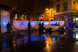 Belgian police cordon off a street in Brussels' Molenbeek district during a police raid in connection with the attacks in Paris.