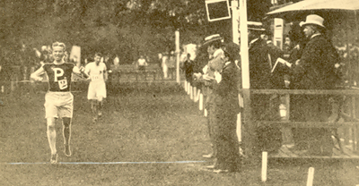 Photograph of Orton crossing the finish line for Olympic gold