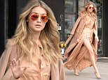 December 8, 2015: Gigi Hadid is pictured this morning leaving her apartment smiling and waiving to the cameras while heading to Kelly and Michael show in New York City. Mandatory Credit: Elder Ordonez/INFphoto.com Ref: infusny-160