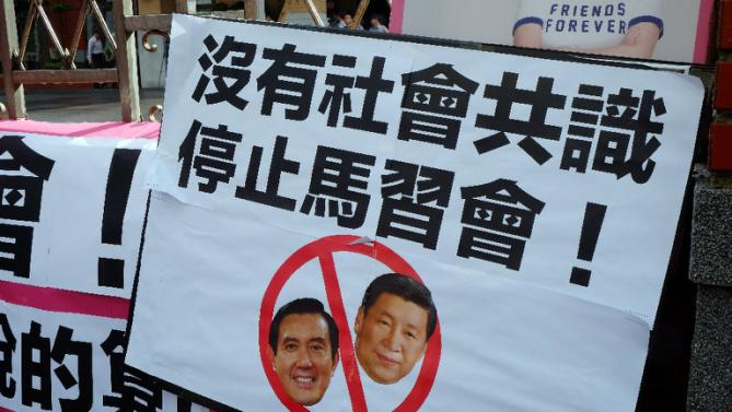 A placard against the meeting between Taiwan's President Ma Ying-jeou and his Chinese counterpart Xi Jinping, due to take place in Singapore this weekend, during a demonstration outside the parliament in Taipei on November 4, 2015