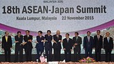 (L-R) Philippine President Benigno Aquino, Singapore's Permanent Secretary for Foreign Affiars Chee Wee Kiong, Thailand's Prime Minister Prayut Chan-O-Cha, Vietnam's Prime Minister Nguyen Tan Dung, Japanese Prime Minister Shinzo Abe, Malaysia's Prime Minister Najib Razak, Laos Prime Minister Thongsing Thammavong, Brunei Sultan Hassanal Bolkiah, Cambodia's Prime Minister Hun Sen, Indonesia's President Joko Widodo and Myanmar President Thein Sein pose for photographers during the 18th ASEAN-Japan Summit in Kuala Lumpur on November 22, 2015, on the sidelines of the 27th Association of Southeast Asian Nations (ASEAN) Summit. Asia-Pacific leaders meeting in Malaysia condemned the string of Islamic extremist attacks from Paris to Mali, urging an international effort to fight the scourge. AFP PHOTO / ADEK BERRY (Photo credit should read ADEK BERRY/AFP/Getty Images)