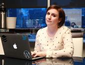 Lena Dunham sits at the computer during a Daily News Live Chat.