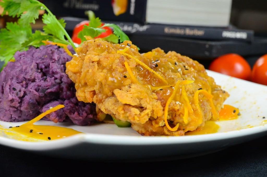 Blackboard Restaurant Crispy chicken thigh with orange reduction on Ube mash