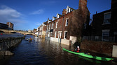 YORK, ENGLAND - DECEMBER 31: Canoeists check out buildings in flooded York on December 31, 2015 in York, England. The Met Office have issued yellow warnings after Storm Frank hit with heavy rain and gale force winds to the North of England and Scotland yesterday. (Photo by Nigel Roddis/Getty Images)