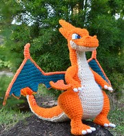 http://www.ravelry.com/patterns/library/mega-charizard-y