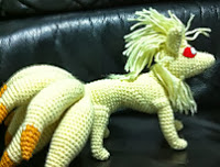 http://www.ravelry.com/patterns/library/ninetales-amigurumi-pokemon-pattern