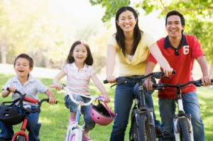 Family on bikes outdoors smiling