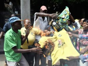 ANC members from Hammanskraal, Ward 49, set alight a T-shirt with President Jacob Zuma's face printed on it outside the party's Tshwane regional office in a protest against alleged branch vote-rigging. The selection of candidates has resulted in violence erupting in KZN. Picture: Oupa Mokoena/Independent Media