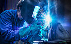 man with welding iron and protective eye cover