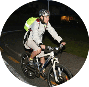Cyclist pictured at night in helmet and hi viz gear