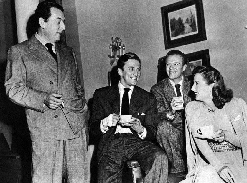 Director Lewis Milestone with three of Strange Love of... stars