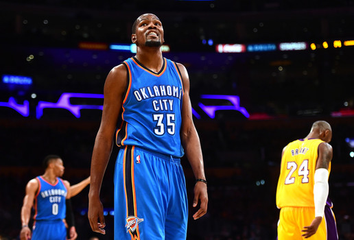 LOS ANGELES, CA - DECEMBER 23: Kevin Durant #35 of the Oklahoma City Thunder reacts after a play in front of Kobe Bryant #24 of the Los Angeles Lakers and Russell Westbrook #0 during a 120-85 Thunder win at Staples Center on December 23, 2015.