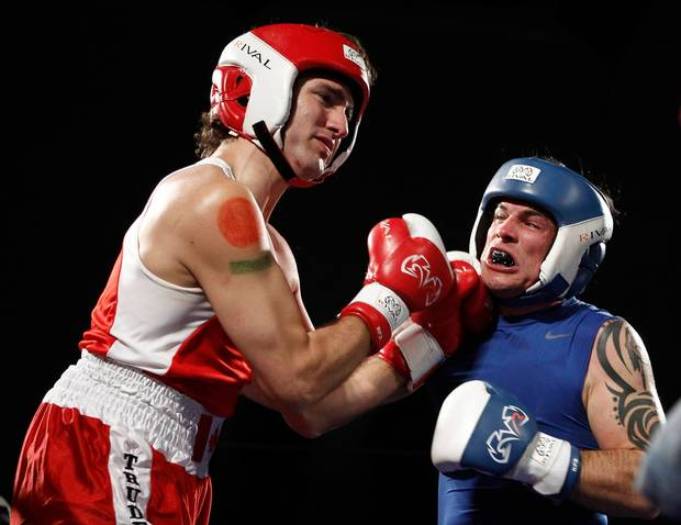 Justin Trudeau and Conservative Senator Patrick Brazeau fight during their charity boxing match in Ottawa on March 31, 2012.