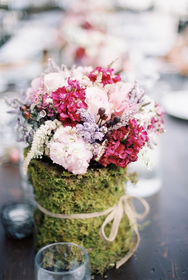 pink flowers in moss covered jars, wedding floral centerpieces, Rustic Wisconsin Resort Wedding, Emily Steffen Photography