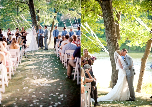 ribbon backdrop for wedding ceremony, bride and groom, first kiss as husband and wife, Rustic Wisconsin Resort Wedding, Emily Steffen Photography
