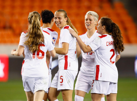 Canada players celebrate Rebecca Quinn's hat-trick