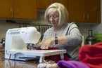 Barbara Evans converts old bedsheets, blankets and pillowcases into beautiful clothes and items for impoverished children around the world. Antonie Robertson / The National