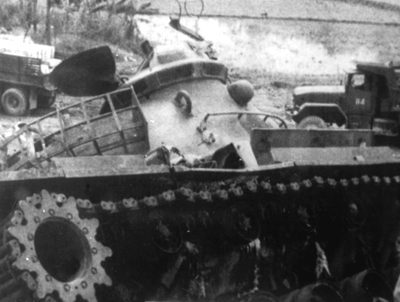 PICTURE - DISABLED M4H OF THE SOUTH VIETNAMESE 20TH TANK REGIMENT. Road wheels received hit from rocket near My Chanh River.