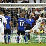 Real Madrid's Portuguese forward Cristiano Ronaldo (R) scores