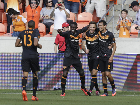 Houston Dynamo players celebrate their second goal
