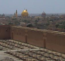 View of Samarra, Iraq from the spiral minaret of the Friday mosque. Two Shi'i shrines dominate the city; the golden over the tomb of 11th Imam, Hassan al-Askari, the coloured over the tomb of 10th Imam, Ali al-Hadi.