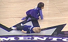 Baby loses crawling race at basketball game by taking a nap mid-way through