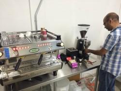 Melind John works their La Marzocco inside Josuma Coffee Company