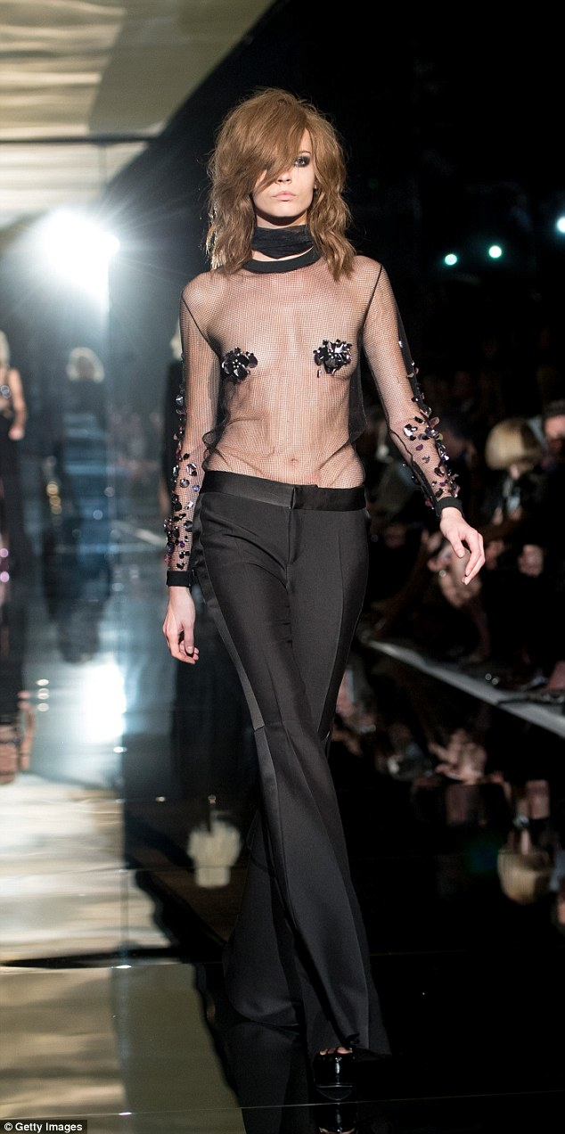 Nearly naked: Models at Tom Ford covered up with sequin detailing