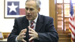 Governor Greg Abbott talks with reporters during an interview in his office on December 4, 2015.