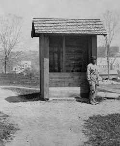 Charles Thompson at the College well, ca. 1860.