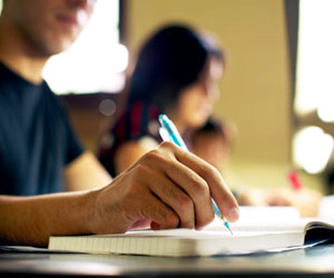 This is a photo of a student taking notes by hand.