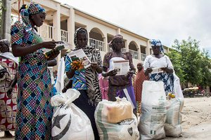 Women check their monthly food rations