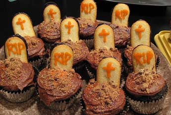 Chocolate cupcake Halloween party snacks with powdered Butterfinger