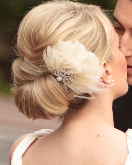 Vintage wedding updo with feather fascinator