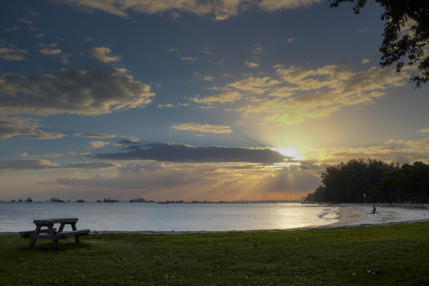 http://www.dreamstime.com/royalty-free-stock-image-sunset-east-coast-park-setting-sun-warms-you-to-bench-image48979336