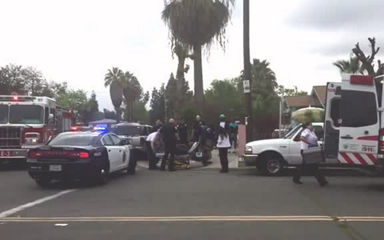Man wounded by gunfire in Fresno loaded into ambulance