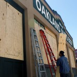 Oakland Auto Body boards up its windows in preparation for protests if an unpopular verdict is reached in Los Angeles. (CALIFORNIA BEAT PHOTO)