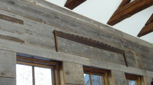 Exposed beams and barn board were sourced from an 1800's Maine farm