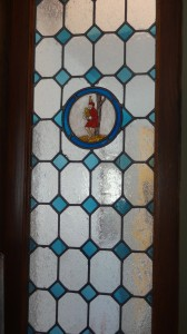 Antique stained glass inset in smoking room walls