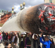 Advocates for federal legalization of marijuana carry a giant inflated joint./Photo by John Zangas