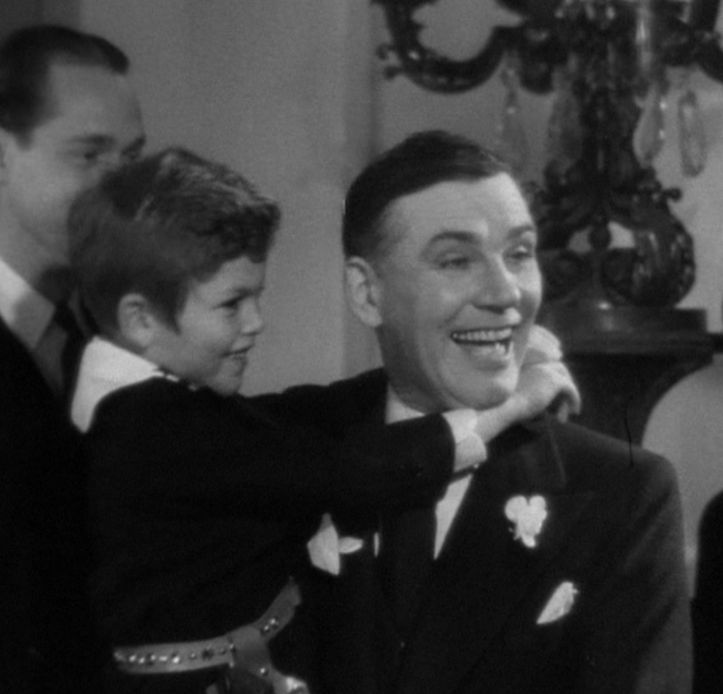 With Walter Huston in Gabriel Over the White house (1933), playing the president's nephew