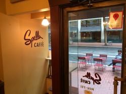 Sidewalk patio seating as viewed from inside Spella Caffè