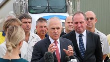 Malcolm Turnbull, standing in front of a truck, gestures as he speaks to truck drivers.