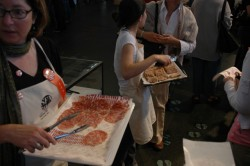 Hand-outs in line at the Charcuterie Pavilion